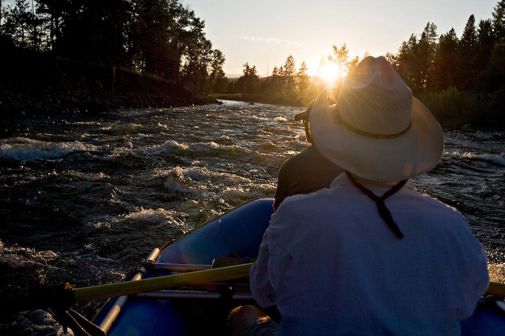 Anglers use an inflatable raft to fly fish the Blackfoot River near Missoula Montana.