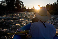 Anglers use an inflatable raft to fly fish the Blackfoot River near Missoula Montana.
