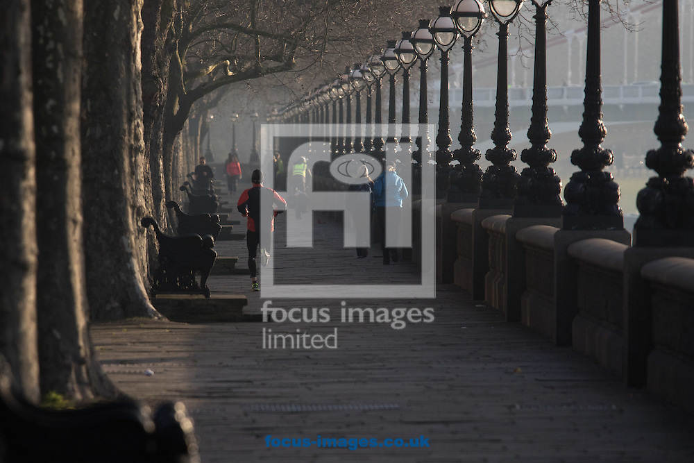 A runner enjoys the early morning sunshine as he jogs beside the River Thames at Cheyne Walk, London <br /> Picture by Paul Davey/Focus Images Ltd +447966 016296<br /> 24/02/2016