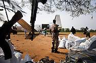 Relief organizations unload humanitarian supplies at an airstrip in the Nuba Mountains on July. 5, 2011 at the begining of the conflict.