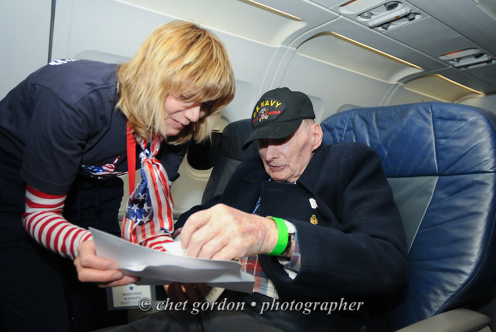 Mail call aboard the departing charter flight from Reagan National Airport in Arlington, VA on Saturday, October 18, 2014. Seventy-five WWII Veterans from the Westchester County area toured the WWII Memorial and Arlington National Cemetery onboard the inaugural flight from Westchester County Airport in White Plains, NY. Hudson Valley Honor Flight is a chapter of the Honor Flight Network, which provides free flights for WWII Veterans and tours of the WWII Memorial constructed in their honor, and other sites in the nation's capital.  © www.chetgordon.com