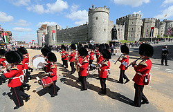 A  Guards band march past Windsor Castle for the state visit of The President of the United Arab Emirates, Sheikh Khalifa bin Zayed Al Nahyan. Tuesday, 30th April 2013 Photo by: Stephen Lock / i-Images