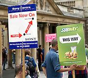 Street advertising signs held by men, Bath