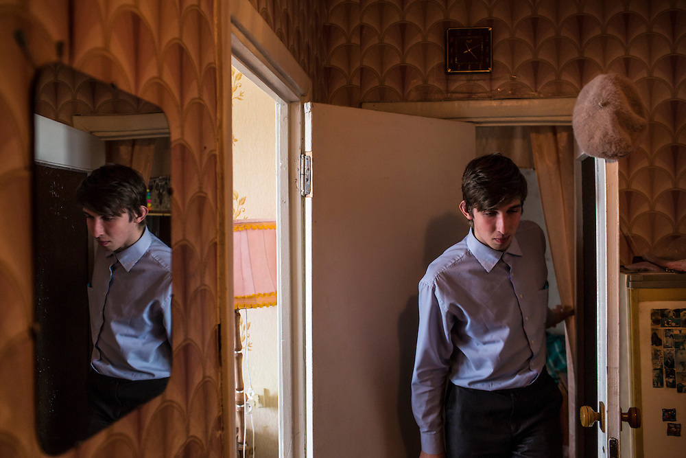 LUHANSK, UKRAINE - MARCH 15, 2015: Pavel Pavlov in his mother's apartment in Luhansk, Ukraine. CREDIT: Brendan Hoffman for The New York Times