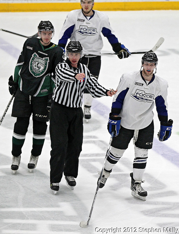 Linesman Dan Cohen (center) separates Roughriders' Blake Butzow (2) and Force's Colton Hargrove (7) during the game at the Cedar Rapids Ice Arena, 1100 Rockford Road SW in Cedar Rapids on Saturday evening, February 18, 2012. (Stephen Mally/Freelance)