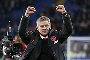 Manchester United interim Manager Ole Gunnar Solskjaer celebrates with United fans during the Premier League match between Cardiff City and Manchester United at the Cardiff City Stadium, Cardiff, Wales on 22 December 2018.