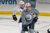 KELOWNA, BC - SEPTEMBER 22:  Josh Archibald #15 and Evan Bouchard #75 of the Edmonton Oilers practice at Prospera Place on September 22, 2019 in Kelowna, Canada. (Photo by Marissa Baecker/Shoot the Breeze)