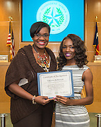 Wanda Adams, left, poses for a photograph with Takyera Roberson, right, during the Board of Trustees meeting, June 11, 2015.