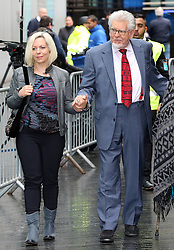 Rolf Harris holds hands with his daughter Bindi as he arrives at Southwark Crown Court in  London, Thursday, 8th May 2014. Picture by Stephen Lock / i-Images