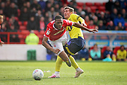 Nottingham Forest's Molla Wague (13)  feels this challenge from Blackburn Rovers midfielder Joe Rothwell (8)  during the EFL Sky Bet Championship match between Nottingham Forest and Blackburn Rovers at the City Ground, Nottingham, England on 13 April 2019.