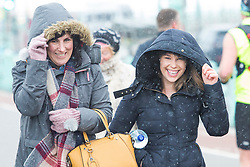 © Licensed to London News Pictures. 17/03/2018. Brighton, UK. members of the public dress up for cold weather in Brighton and Hove as snow is falling on the south coast. Photo credit: Hugo Michiels/LNP