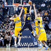 10 April 2016: Utah Jazz forward Trey Lyles (41) goes for the layup between Denver Nuggets center Nikola Jokic (15) and Denver Nuggets center Jusuf Nurkic (23) during the Utah Jazz 100-84 victory over the Denver Nuggets, at the Pepsi Center, Denver, Colorado, USA.