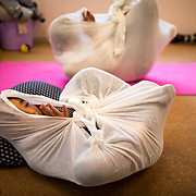 """TOKYO, JAPAN - JANUARY 29 : Participants wrapped in a white cloth during a workshop called """"Otonamaki"""", which directly translates to adult wrapping, Tokyo, Japan on Sunday, January 29, 2017. Otonamaki is a Japanese therapeutic method meant to alleviate posture problems and stiffness. (Photo by Richard Atrero de Guzman/ANADOLU Agency)"""
