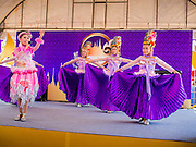 19 APRIl 2014 - BANGKOK, THAILAND:  Girls perform a traditional Thai country song at the Rattanakosin Festival in Bangkok. Rattanakosin is the name of the man made island that is the heart of the old city. Bangkok was formally founded as the capital of Siam (now Thailand) on 21 April 1782 by King Rama I, founder of the Chakri Dynasty. Bhumibol Adulyadej, the current King of Thailand, is Rama IX, the ninth King of the Chakri Dynasty. The Thai Ministry of Culture organized the Rattanakosin Festival on Sanam Luang, the royal parade ground in the heart of the old part of Bangkok, to celebrate the city's 232nd anniversary.    PHOTO BY JACK KURTZ