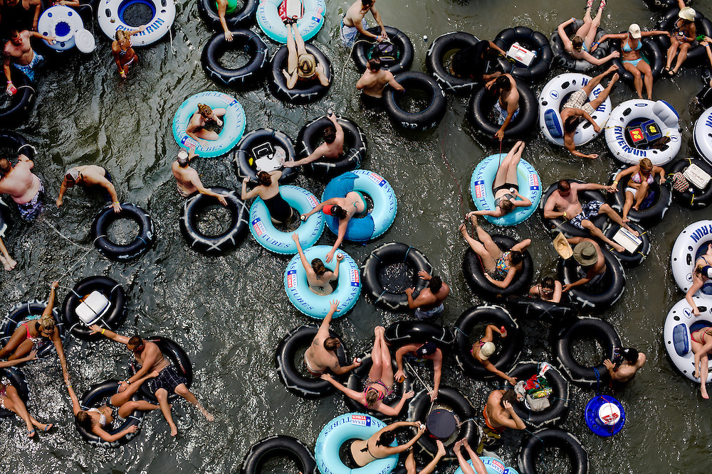 Tubers make their way down the Comal River near Prince Solms Park in New Braunfels on Memorial Day.