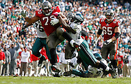 OCTOBER 11, 2009, PHILADELPHIA, PA: Tackle Donald Penn #70 of the Tampa Bay Buccaneers advances a deflected pass he caught against the Philadelphia Eagles at Lincoln Financial Field in Philadelphia, Pennsylvania on October 11, 2009. The Buccaneers lost 33-14. Photo by Mike Carlson/Tampa Bay Buccaneers