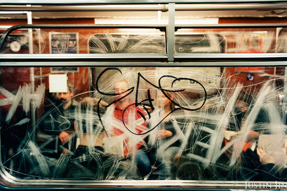 Graffitti splash across the window of a Berlin metro. .Picture taken 2005 by Justin Jin