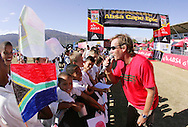 VILLIERSDORP, SOUTH AFRICA - The crowd is entertained by Mike during the Adidas Big Tree Foundation Schools Soccer Tournament Final held during stage two of the Absa Cape Epic Mountain Bike Stage Race held between Gordon's Bay and Villiersdorp on the 23 March 2009 in the Western Cape, South Africa..Photo by Ron Gaunt /SPORTZPICS