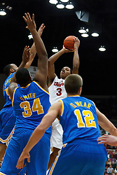 Dec 29, 2011; Stanford CA, USA;  Stanford Cardinal guard/forward Anthony Brown (3) shoots over UCLA Bruins center Joshua Smith (34), guard Jerime Anderson (left) and forward David Wear (12) during the first half at Maples Pavilion.  Mandatory Credit: Jason O. Watson-US PRESSWIRE