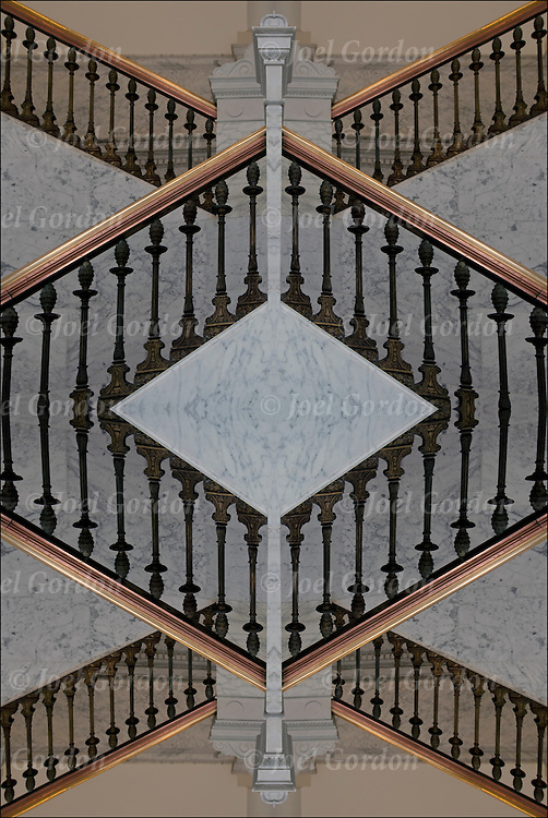Abstract of mirror and scaled marble stairway. A stairway, giving the idea of an invitation to see what lies beyond, stairs leading up and down to where?