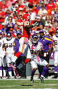 Kansas City Chiefs defensive back Donald Washington (27) leaps in the air while trying to break up a pass reception good for a second quarter first down to Minnesota Vikings wide receiver Percy Harvin (12) during the NFL week 4 football game against the Minnesota Vikings on Sunday, October 2, 2011 in Kansas City, Missouri. The Chiefs won the game 22-17. ©Paul Anthony Spinelli