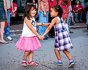 Young street dancers enjoying the music of 60's British Invasion cover band The GB's at the May 2018 DADA Gallery Hop in Winston-Salem, North Carolina.