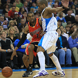 30 January 2009:  Golden State Warriors guard C.J. Watson (23) drives against New Orleans Hornets guard Antonio Daniels (50) during a 91-87 loss by the New Orleans Hornets to Golden State Warriors at the New Orleans Arena in New Orleans, LA.