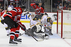 Jan 19; Newark, NJ, USA; New Jersey Devils center Adam Henrique (14) shoots the puck just wide of Boston Bruins goalie Tim Thomas (30) net during the second period at the Prudential Center.