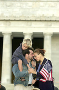 September 14, 2001_Lincoln Memorial, Washington,DC.Mark Notturno, Kira Viktorova, his wife and 6 year old son, Karl comfort each other on the steps of the Lincolm Memorial in Washington, DC..They like many other people across the US came out at 7PM to light candles for those that died or where injured by terrorists acts this week across the US.  .(C) 2001 Sandy Schaeffer / MAI / TimePix