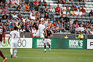 July 24th, 2012:  Swansea City AFC striker Stephen Dobble (14) out jumps Colorado Rapids defender Hunter Freeman (2) in the Colorado Rapids 2-1 victory over Swansea City AFC in a international friendly soccer match in Denver, CO.