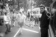 Ravers dancing in the street at the 2nd Criminal Justice March, Victoria, London, UK, 23rd of July 1994.