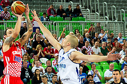 Damir Markota #12 of Croatia shots against Tuukka Kotti #10 of Finland during basketball match between national team of Finland and Croatia of Eurobasket 2013 on September 12, 2013 in SRC Stozice, Ljubljana, Slovenia. (Photo By Matic Klansek Velej / Sportida.com)