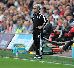 West Bromwich Albion Manager, Alan Irvine stands on the touchline with his hands on his hips. - Photo mandatory by-line: Alex James/JMP - Mobile: 07966 386802 30/08/2014 - SPORT - FOOTBALL - Swansea - Liberty Stadium - Swansea City v West Brom - Barclays Premier League