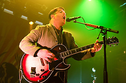 © Licensed to London News Pictures. 14/04/2014. London, UK.   Augustines performing live at KOKO.   In this picture - Billy McCarthy.  Augustines is an American indie rock Group consisting of Billy McCarthy (guitar), Eric Sanderson (multi-instruments) and Rob Allen (drummer).  Augustines were previously known as 'We Are Augustines'.   Photo credit : Richard Isaac/LNP