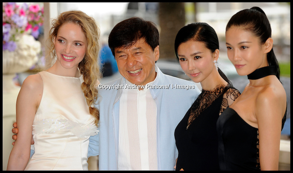 L TO R Laura Weissbecker (white dress,left) Jackie Chan, Yeo Xingtong and  Zhang Nan Xin pose for photographers in Cannes while promoting Jackie Chan's new film Chinese Zodiac, Friday 18th May 2012. Photo by Andrew Parsons/i-Images.