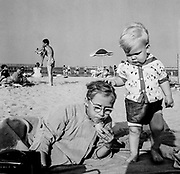 On jones Beach Long Island, New York, on a blanket in the sand with visiting baby moocher on a fine warm sunny day by the seaside at Zach's Bay