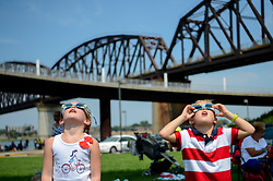 August 21, 2017 - Louisville, Kentucky, U.S. - CALLAWAY and BECKETT POWERS uses solar filtered glassed to look at the sun during a solar eclipse.  The eclipse is the first coast-to-coast solar eclipse in almost 100 years and will pass across the U.S. at 2,000 mph. (Credit Image: © Bryan Woolston via ZUMA Wire)