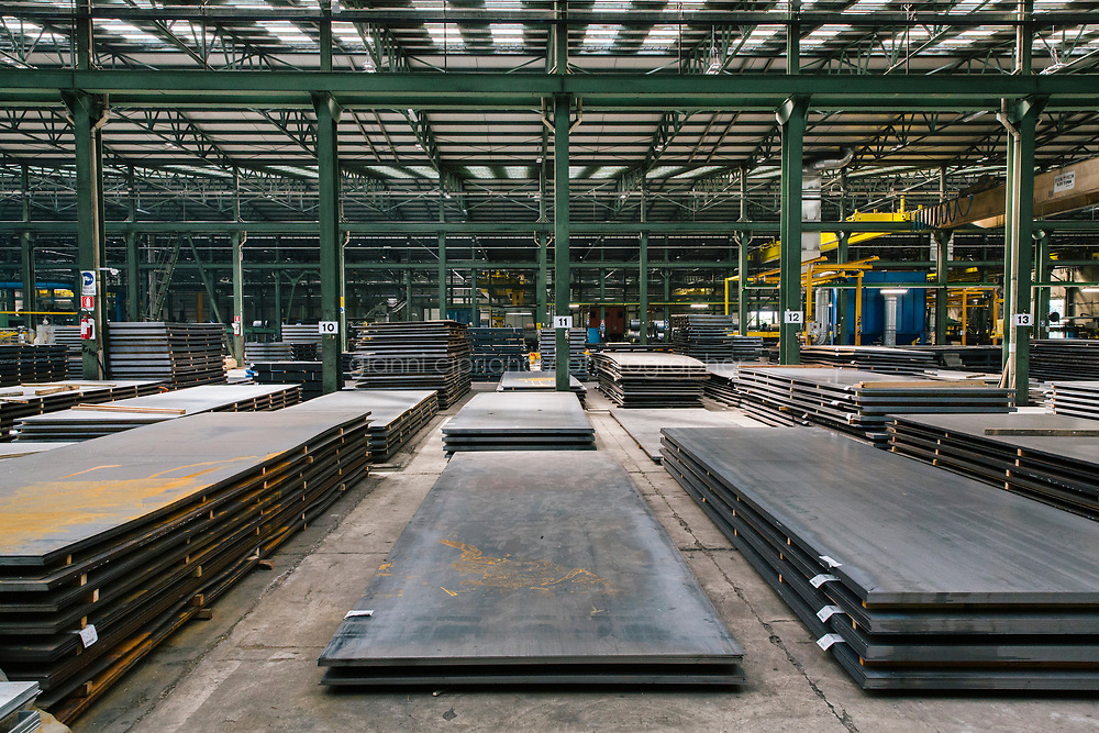 SANTA MARIA DEGLI ANGELI (ASSISI), ITALY - 11 JUNE 2018: Steel sheets are spread throughout the  IRON S.p.A. factory, a publicly traded company that makes industrial steel parts, in Santa Maria degli Angeli (Assisi), Italy, on June 11th 2018.<br /> <br /> President Donald Trump&rsquo;s administration plans to impose tariffs on European steel and aluminum imports after failing to win concessions from the European Union, a move that could provoke retaliatory tariffs and inflame trans-Atlantic trade tensions. Until the moment that the American president rendered his decision, Mr. Capponi, the commercial director of IRON spa, was confident the continent would be spared.<br /> Given that IRON is a purchaser of steel, the company might benefit from the American tariffs. Steel now shipped to the United States from mills within Europe might stay here to avoid the tariffs, raising the supply and dropping prices. Chinese producers who export to American shores could divert their product to Europe, amplifying this trend.<br /> But Mr. Capponi was banking on none of this. Even if steel prices decline, his customers are likely to squeeze him for lower prices. More broadly, the American tariffs &mdash; justified by the Trump administration as a supposed defense of national security &mdash; reverberated as a blow against world trade.