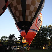 Hot air balloons prepare to launch around rural Michigan near Battle Creek during competition in the 20th FAI World Hot Air Ballooning Championships. Battle Creek, Michigan, USA. 23rd August 2012. Photo Tim Clayton