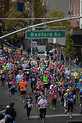 Participants run along Lafayette St as they approach Bedford Ave in the New York City Marathon in Brooklyn, NY on Sunday, Nov. 3, 2013.<br /> <br /> CREDIT: Andrew Hinderaker for The Wall Street Journal<br /> SLUG: NYSTANDALONE