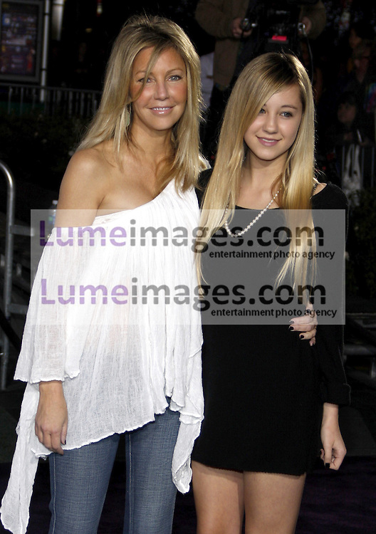 Heather Locklear and Ava Sambora at the Los Angeles premiere of 'Justin Bieber: Never Say Never' held at the Nokia Theatre L.A. Live in Los Angeles on February 8, 2011. Credit: Lumeimages.com