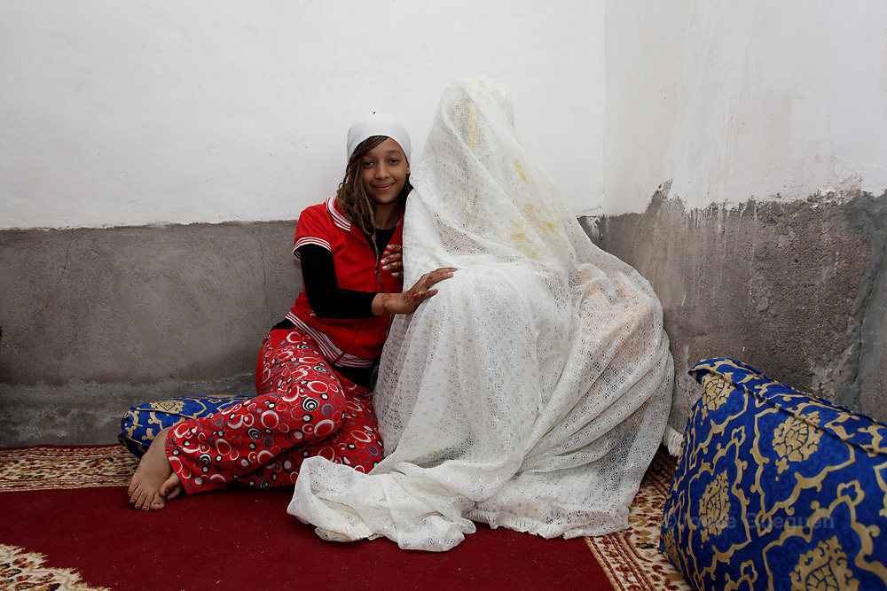 The bride Sokaina is meeitng with relatives in the family home one day before the celebration of her wedding to Omar in Tikirt Village South East Morocco