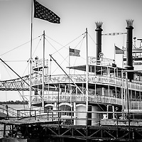 Natchez Steamboat in New Orleans black and white picture. The Natchez Steamboat is a sternwheel paddle wheel steamer that provides cruises on the Mississippi River.