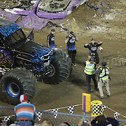 Son-uva Digger driven by Ryan Anderson celebrates his victory at the  Monster Jam Orlando big truck event at the Citrus Bowl in Orlando, Florida on Saturday, January 25, 2014. (AP Photo/Alex Menendez)