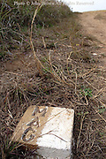A marker indicating an area cleared of unexploded ordnance (UXO) by the Lao Mines Advisory Group (LMAG) serves tourists well at the Plain of Jars archeological site in Xiang Khoang, (Xieng Khouang, Phonsavan) Laos. The United States reportedly dropped some 90 million cluster bombs on Laos during Second Indochina War. These bombs had a reported 10 to 30 percent failure rate, which meant that millions of them as well as many larger bombs hit the ground and remain unexploded. .