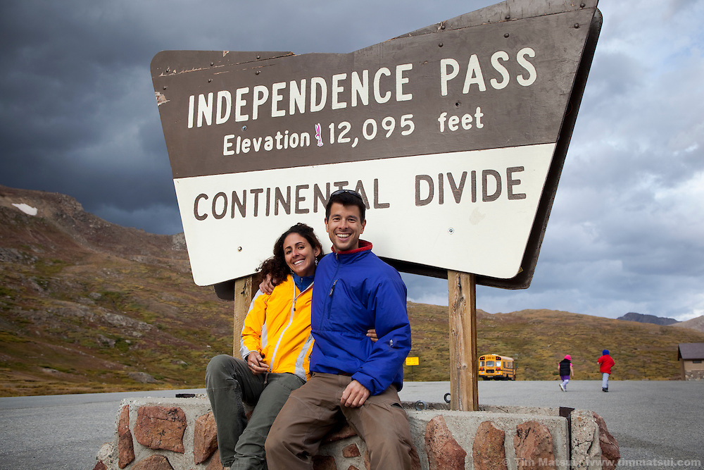 A happy young couple pose at Independence Pass on the Continental Divide.