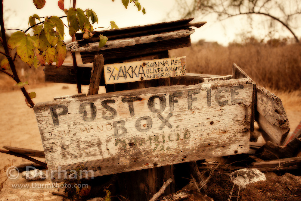 A postal exchange on the beach of Floreana Island. An old whisky barrel houses postcards from visitors the world over, each left in the hope that others will take their postcard home and deliver it. The Post Office Bay tradition has been going for over 200 years, since UK mariners set it up to allow packages and letters to be deposited and picked up by other passing ships en route to the appropriate destinations. Galapagos Archipelago, Ecuador.