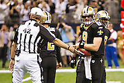 NEW ORLEANS, LA - DECEMBER 26:   Quarterback Drew Brees #9 of the New Orleans Saints is given the ball by the Referee after Brees throws a nine-yard touchdown pass to running back Darren Sproles #43 and breaks the single-season passing record in the fourth quarter against the Atlanta Falcons at Mercedes-Benz Superdome on December 26, 2011 in New Orleans, Louisiana.  The Saints defeated the Falcons 45-16.  (Photo by Wesley Hitt/Getty Images) *** Local Caption *** Drew Brees