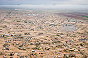 A thick layer of smog hangs over a sparsly settled area of Arizona City. Low density suburban development encourages more auto use, which is a major source of smog-creating pollutants such as nitrogen dioxide, sulfur dioxide, and carbon monoxide, and carbon dioxide.