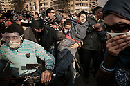 A protester incapacitated by tear gas is swiftly evacuated  by motorbike for treatment during clashes with riot police on Mohamed Mahmoud street off Tahrir Square on November 22, 2011 in Cairo, Egypt.